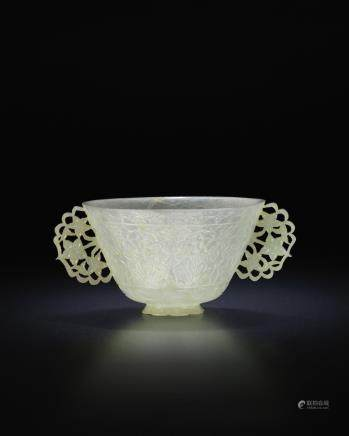 A rare pale green jade two-handled bowl