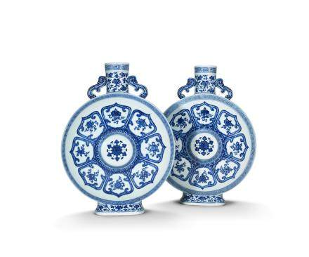 An exceptionally rare pair of Imperial blue and white 'Bajixiang' moonflasks, bianhu