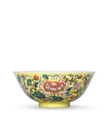An exceptionally rare Imperial famille rose yellow-ground 'floral' bowl