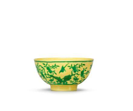 A green and yellow-glazed 'birds and peach' bowl