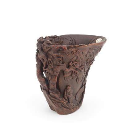 A very rare rhinoceros horn 'scholar and attendant' libation cup