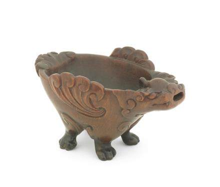 A very rare rhinoceros horn archaistic 'zoomorphic' pouring vessel