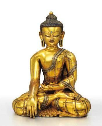 西藏十三/十四世紀  鎏金銅嵌銀釋迦牟尼佛坐像