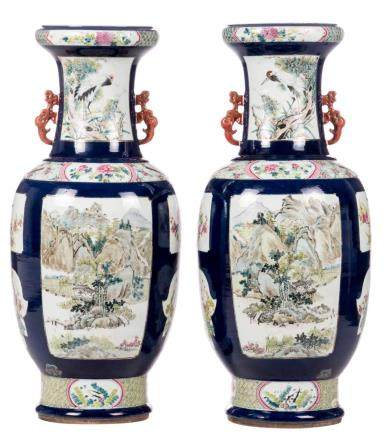 A pair of Chinese vases, blue ground, the roundels famille rose decorated with birds, flower branches and landscapes, 19thC, H 86 cm (minor crack)