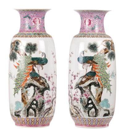 A pair of Chinese famille rose vases, decorated with peacocks, the three friends of winter, bamboo, and a calligraphic text, marked, H 60,7 cm