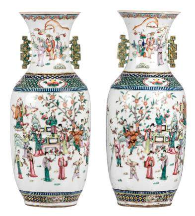 A pair of Chinese famille rose vases, decorated with an animated scene, flower vases and antiquities, 19thC, H 58 cm