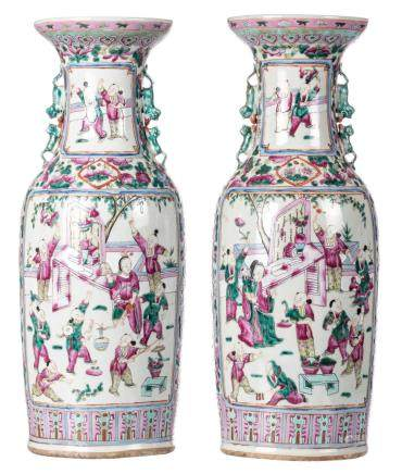 A pair of Chinese famille rose vases, decorated with birds and flower branches, the roundels with animated garden scenes, 19thC, H 58-58,5 cm