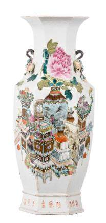 A Chinese famille rose hexagonal vase, decorated with flower vases, antiquities and calligraphic texts, the handles pomegranate shaped, 19thC, H 58 cm (chips)