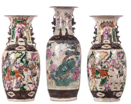 A Chinese famille rose stoneware vase, decorated with birds, flower branches and calligraphic texts, relief decorated, marked, 19thC, H 61,5 cm; added two ditto vases, overall decorated with warriors, H 42,5 cm