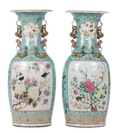 A pair of Chinese turquoise ground vases, overall decorated with birds on flower branches, 19thC, H 80,5 cm (crack and flaking of the glaze)