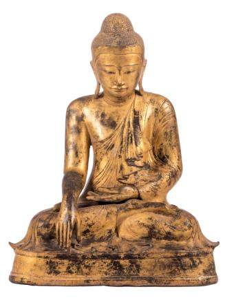 An Oriental gilt bronze seated Buddha, 19thC, H 57 - W 43,5 cm