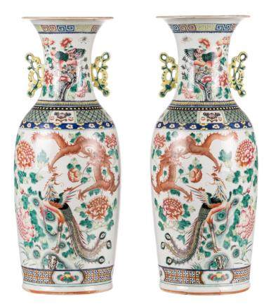 A pair of Chinese famille rose vases, one side decorated with a dragon, a phoenix, birds and flower branches; the other side with antiquities, flower branches and fruits, H 60 cm