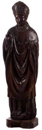 A sculpted walnut statue depicting a bishop, 16thC, H 123 (without base) - 131 cm (with base)