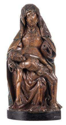 A carved wooden Pieta with traces of polyhrome paint, the Netherlands, 16thC, H 76,5 cm