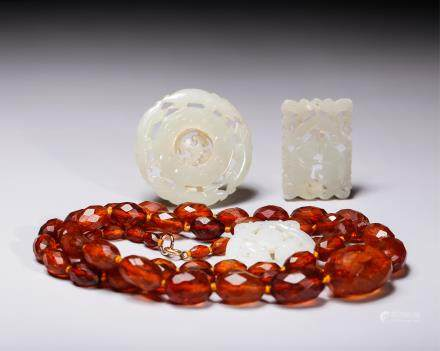 GROUP OF 3 CHINESE JADE PLAQUES AND AMBER NECKLACE