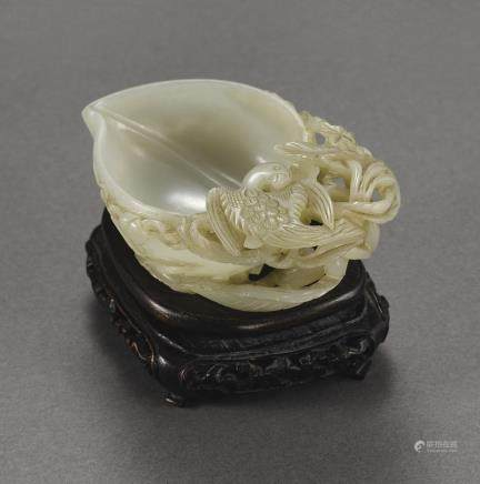 A CELADON JADE PEACH-SHAPED 'PARROT' CUP QING DYNASTY, 19TH CENTURY