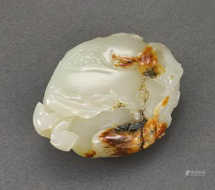 A WHITE AND RUSSET JADE 'POMEGRANATE' CARVING QING DYNASTY