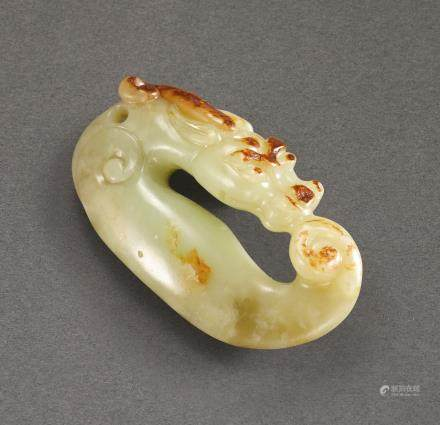 A YELLOW AND RUSSET JADE 'FISH DRAGON' PENDANT QING DYNASTY, 18TH – 19TH CENTURY