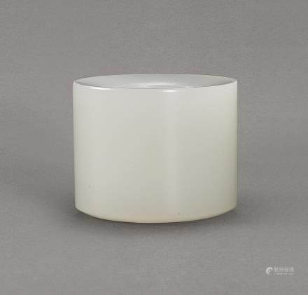 A WHITE JADE THUMBRING LATE QING DYNASTY