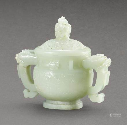 A PALE CELADON JADE ARCHAISTIC DRAGON-HANDLED VESSEL LATE QING DYNASTY – REPUBLICAN PERIOD