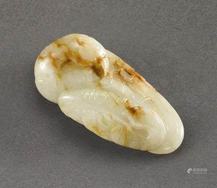 A CELADON AND RUSSET JADE 'PHOENIX' GROUP QING DYNASTY, 17TH – 18TH CENTURY