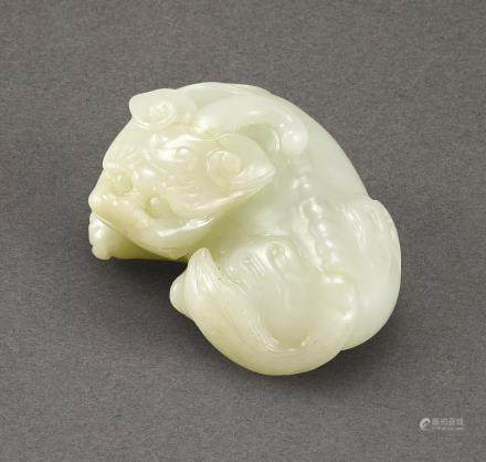 A WHITE JADE FIGURE OF A MYTHICAL BEAST QING DYNASTY