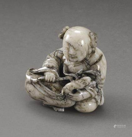 A BLACK AND WHITE JADE 'BOY AND GOOSE' GROUP QING DYNASTY