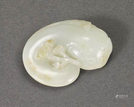 A WHITE JADE 'CATFISH AND LINGZHI' PAPERWEIGHT