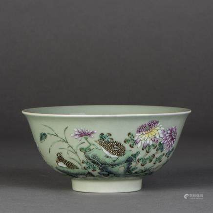 A CELADON GROUND FAMILLE ROSE PORCELAIN BOWL, QING QIANLONG PERIOD