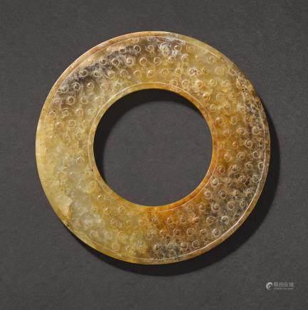 A BROWN AND RUSSET JADE DISC, HUAN WESTERN HAN DYNASTY