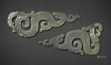 TWO CELADON JADE DRAGON-SHAPED PENDANTS WARRING STATES PERIOD