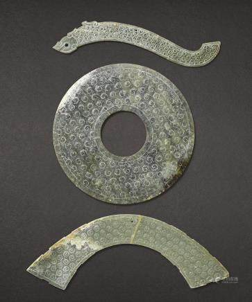 A GREEN JADE DISC, BI AND TWO GREEN JADE ORNAMENTS WARRING STATES PERIOD AND HAN DYNASTY