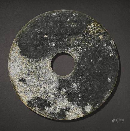 A PARTLY CALCIFIED JADE DISC, BI WARRING STATES PERIOD – WESTERN HAN DYNASTY