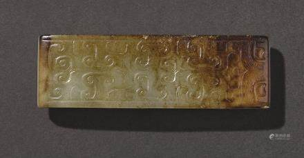 AN ARCHAISTIC CELADON AND RUSSET JADE SCABBARD SLIDE, WEI QING DYNASTY