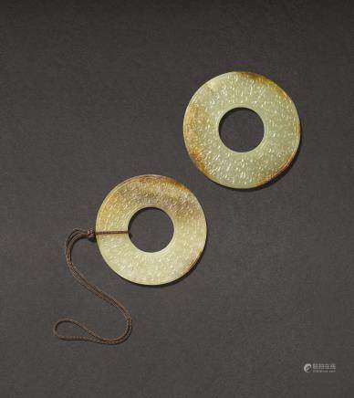 TWO HAN-TYPE CELADON AND RUSSET JADE ARCHAISTIC DISCS, HUAN PROBABLY MING DYNASTY