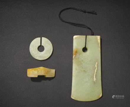 AN ARCHAISTIC PALE CELADON JADE BLADE, A SWORD GUARD AND A SLIT-DISC, JUE