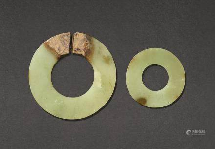 A YELLOW AND BROWN JADE DISC, HUAN AND A SLIT DISC, JUE HAN DYNASTY OR EARLIER