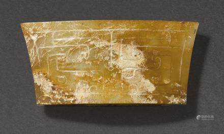 A BROWN AND RUSSET JADE SCABBARD CHAPE PROBABLY WESTERN HAN DYNASTY