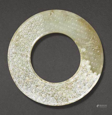 A PARTLY CALCIFIED DISC, HUAN WESTERN HAN DYNASTY