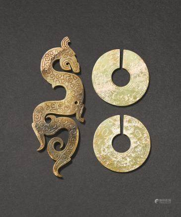 A BROWN JADE DRAGON-SHAPED PENDANT AND TWO ARCHAISTIC SLIT-DISCS, JUE THE PENDANT: PROBABLY WARRING STATES PERIOD