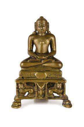 A SMALL BRONZE FIGURE OF A SEATED DEITY, INDIA, 13TH-14TH CENTURY