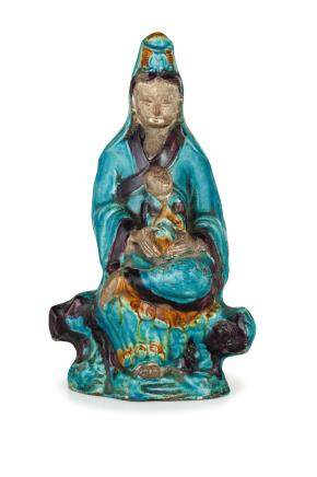 A GLAZED-BISCUIT FIGURE OF GUANYIN AND CHILD, CHINA, 18TH CENTURY