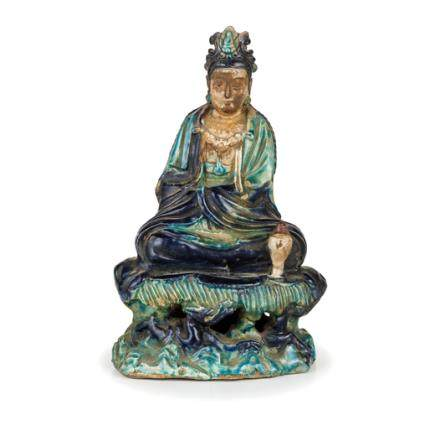 A BISCUIT-GLAZED FIGURE OF A SEATED GUANYIN, CHINA, LATE MING DYNASTY, 16TH - 17TH CENTURY