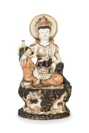 A RARE AND LARGE CIZHOU STONEWARE FIGURE OF A SEATED GUANYIN, CHINA, EARLY MING DYNASTY (1368-1644)
