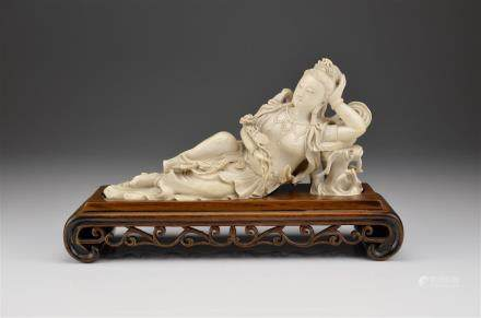 CHINESE CARVED IVORY RECLINING GUANYIN FIGURE