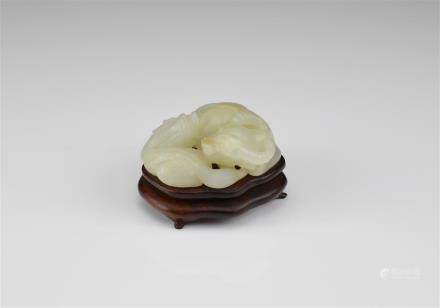 CHINESE CARVED WHITE JADE BUFFALO WITH QILIN