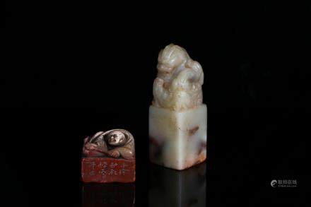 A set of two soapstone carved seals