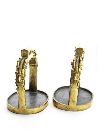 A pair of gilt bronze 'dragon' horse stirrups
