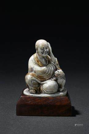 A soapstone gilt-painted luohan