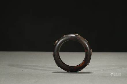 An agarwood 'gold bead' bangle